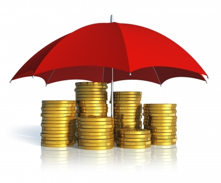 Photo of Red umbrella over stacks of gold coin representing Security Deposit